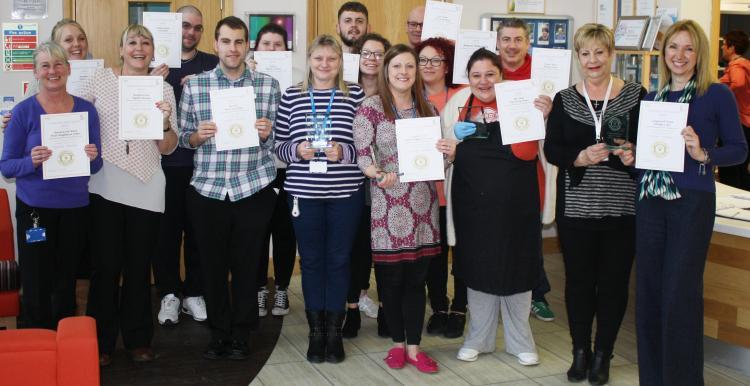 staff recieving a carers award
